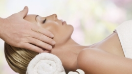 woman relaxing to head massage
