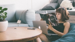 Woman relaxing while reading a book and lounging